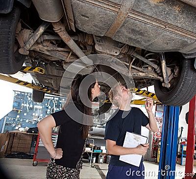 Mechanic Showing Customer Repairs