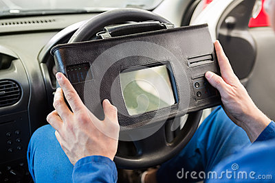 Mechanic using diagnostic tool in the car stock photo for Garage diagnostic auto