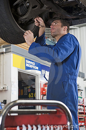 Free Mechanic Working Under Car Stock Photography - 5940832