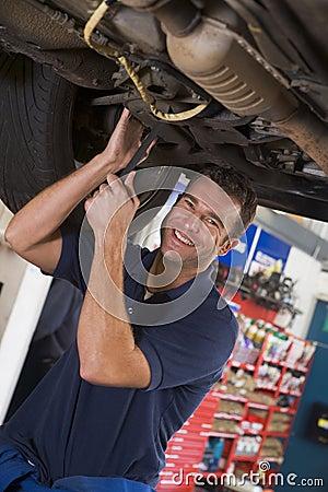 Free Mechanic Working Under Car Stock Photo - 5940870