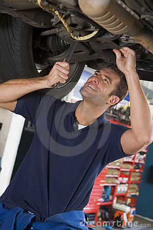 Free Mechanic Working Under Car Royalty Free Stock Images - 5940879