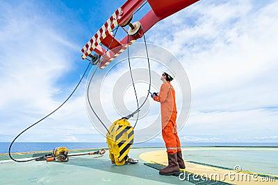 Mechanical crane inspector inspect crane system as annual preventive maintenance schedule. Stock Photo