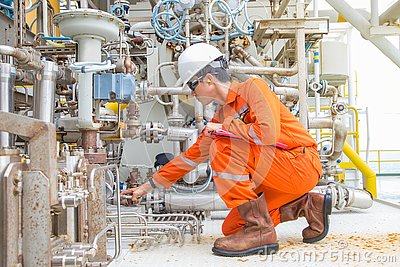 Mechanical engineer checking and inspect lube oil system of centrifugal gas compressor at offshore gas platform. Stock Photo