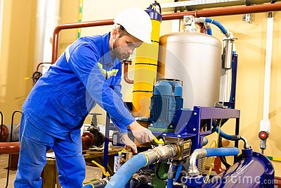 Mechanical engineer services industrial oil equipment on gas refinery. Stock Photo