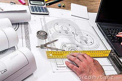 Mechanical engineering of parts with tools, laptop, Stock Photo