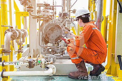 Mechanical inspector inspection oil pump centrifugal type. Offshore oil and gas industry maintenance activities Stock Photo