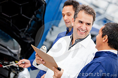 Mechanics at a car garage