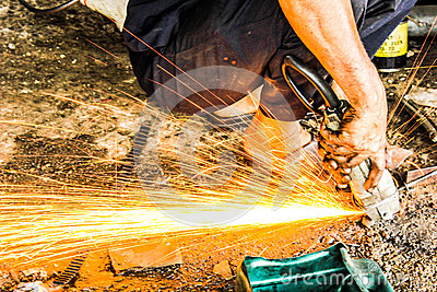 Mechanics repairing steel sparks fire light in auto car shop sta