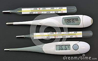 Medecine stuff. Digital and mercuric thermometers