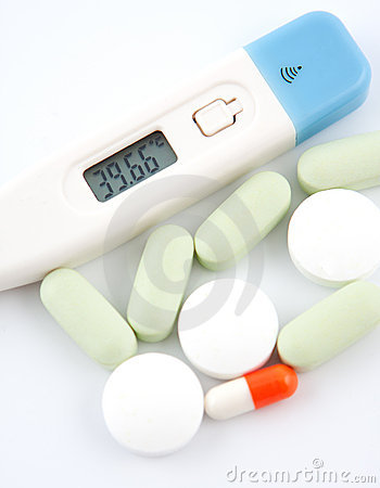Medecine stuff. Digital thermometer and pills