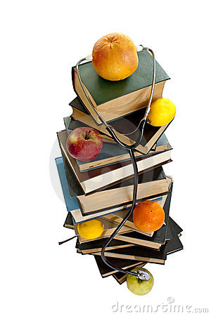 Medical books with fruits