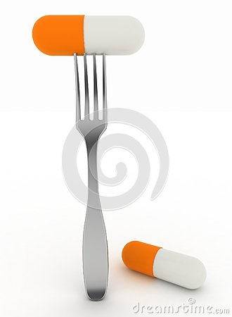 Medical capsule on dinner fork