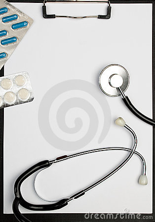 Medical clipboard, stethoscope and pills