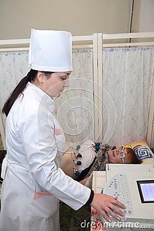 Medical doctor making ECG