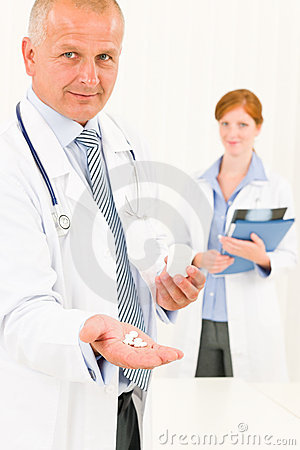 Medical Doctor Team Senior Male Hold Pills Stock Image - Image: 20510821