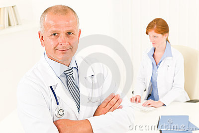 Medical doctor team senior male young woman