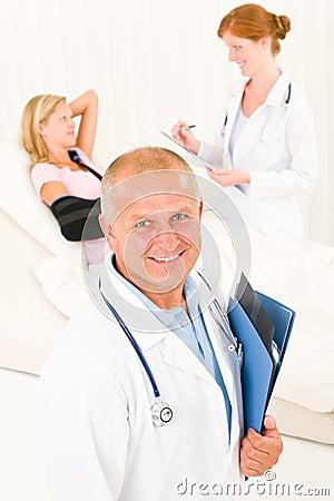 Medical doctors with hospital patient broken arm