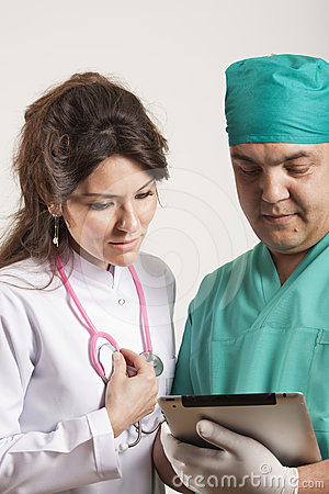 Medical doctors looking at tablet