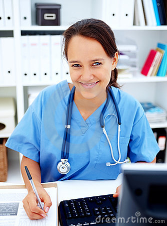 Medical - Friendly female nurse smiling happily