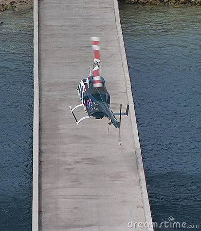 Medical Helicopter Landing on Pier