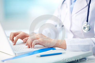 Medical person typing