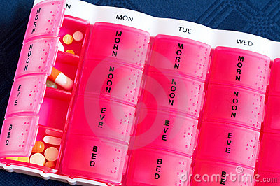 Medical pills in the pink box