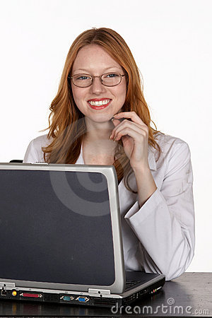 Medical Professional in Lab Coat at Laptop Computer