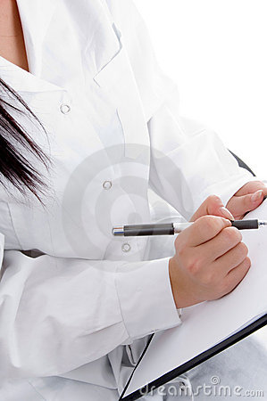 Medical professional writing prescription