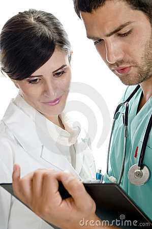 Medical professionals looking in writing pad