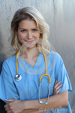Free Medical Professionals: Woman Nurse Smiling While Working At Hospital. Young Beautiful Blond Caucasian Female Health Care Worker Royalty Free Stock Photography - 82241437