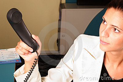 Medical secretary handing a phone to the doctor