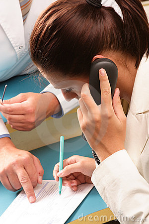 Free Medical Secretary Making An Appointment By Phone Royalty Free Stock Photo - 985425