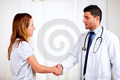 Medical specialist greeting a beautiful patient