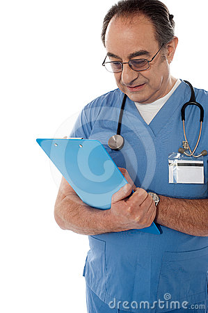 Medical specialist studying report