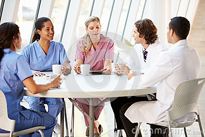 Medical Staff Chatting In Modern Hospital Canteen