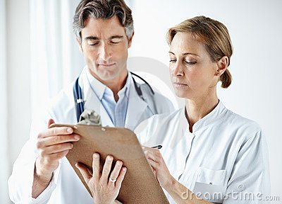 Medical staff filling a report together