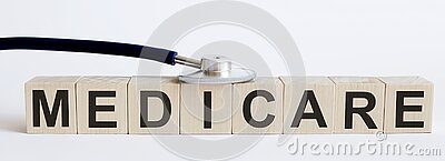 Medical stethoscope with wood block text MEDICARE. Medical stethoscope , wood block MEDICARE stock photography