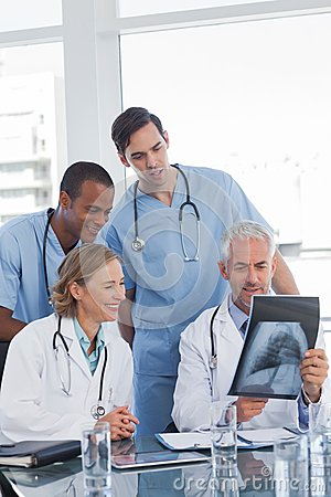 Medical team examining radiography