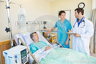 Medical Team Looking At Each Other While Patient