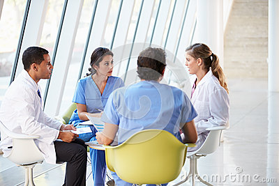 Medical Team Meeting Around Table