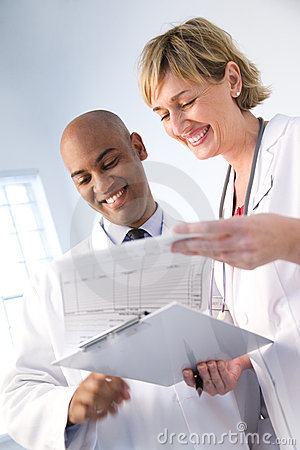 Free Medical Team Reviewing Chart Royalty Free Stock Image - 5645576