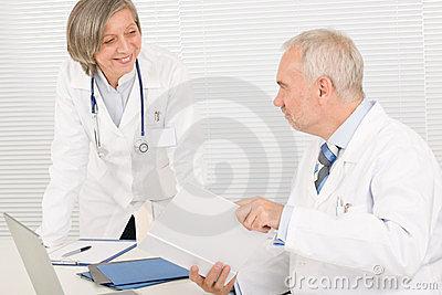 Medical team senior doctor with work colleague
