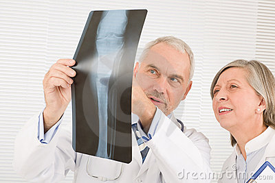 Medical team senior doctors look at x-ray
