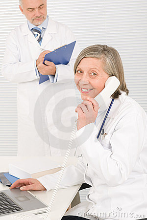 Medical team senior female phone male colleague