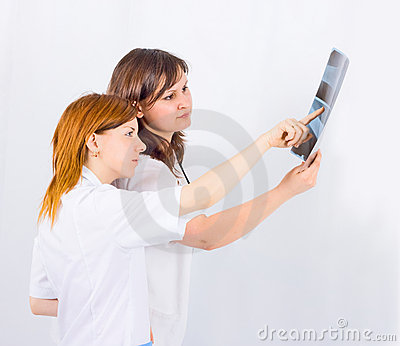 Medical team of two study an x-ray