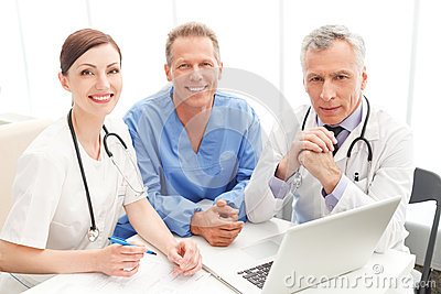 Medical team at work. Cheerful medical team sitting together at