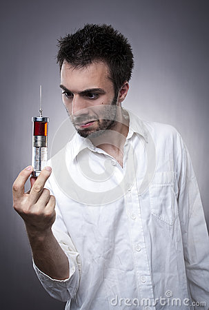 Medical worker holding a syringe