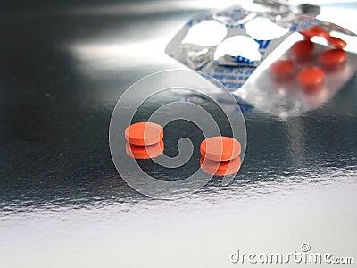 Medicinas anaranjadas llenas