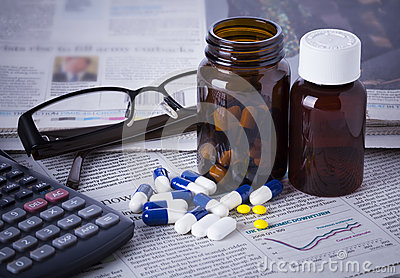 Medicine bottles, pills and financial data