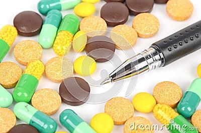 Medicine and pen